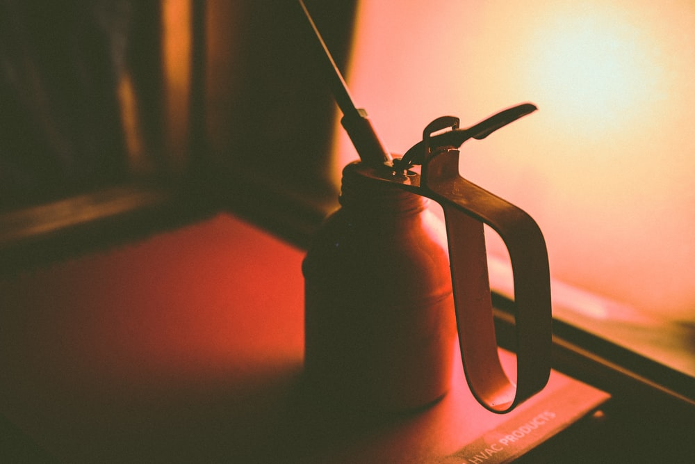 selective focus photography of oil can