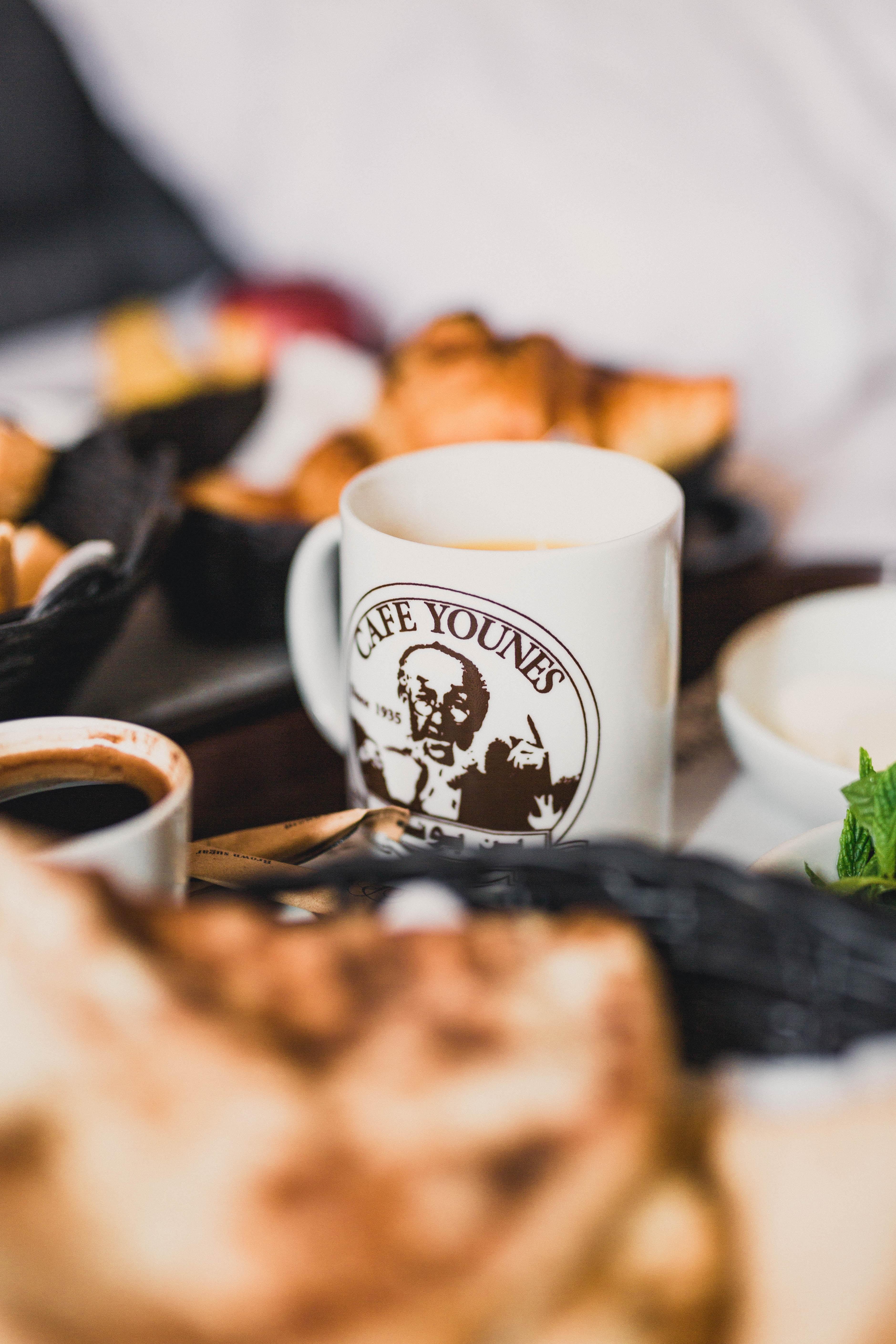 white ceramic mug beside bowl
