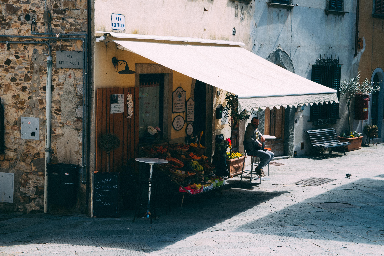 man sitting under awning during daytime