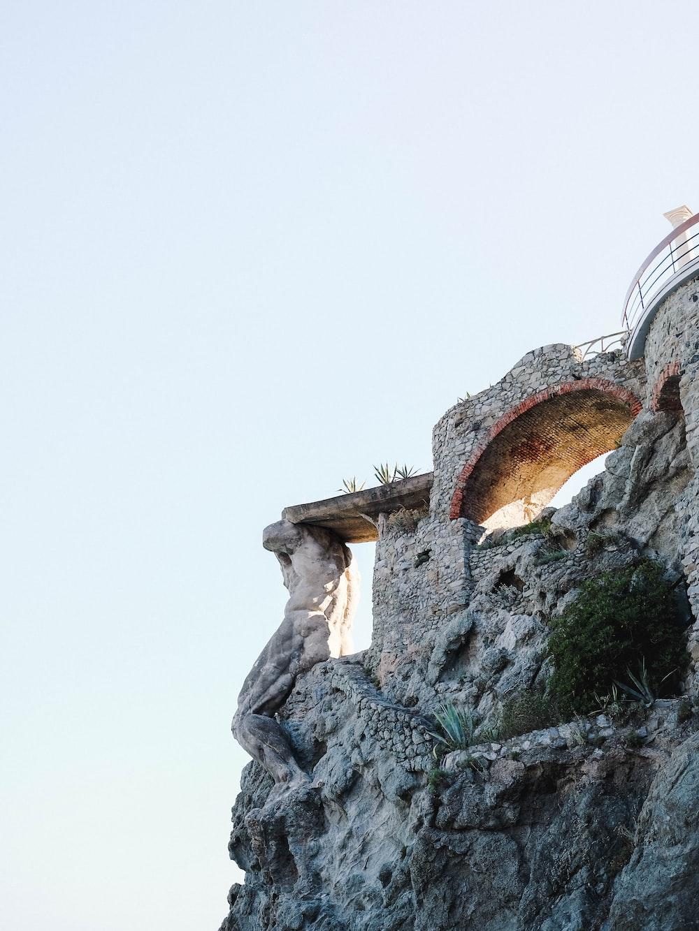 stone structure near cliff