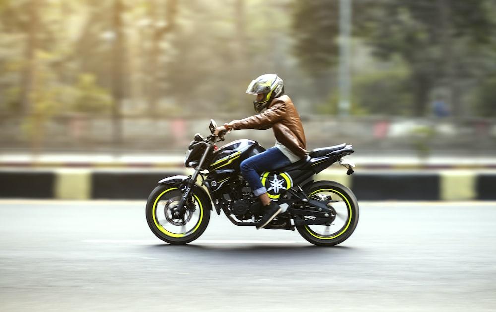time lapse photography of man riding sports bike