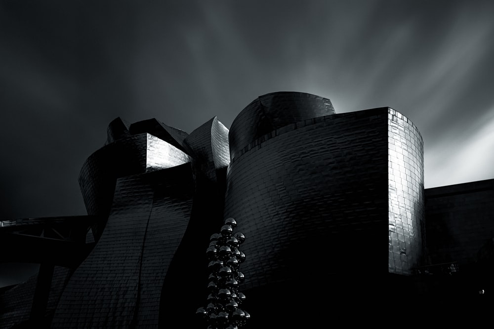 grayscale photo of concrete structure
