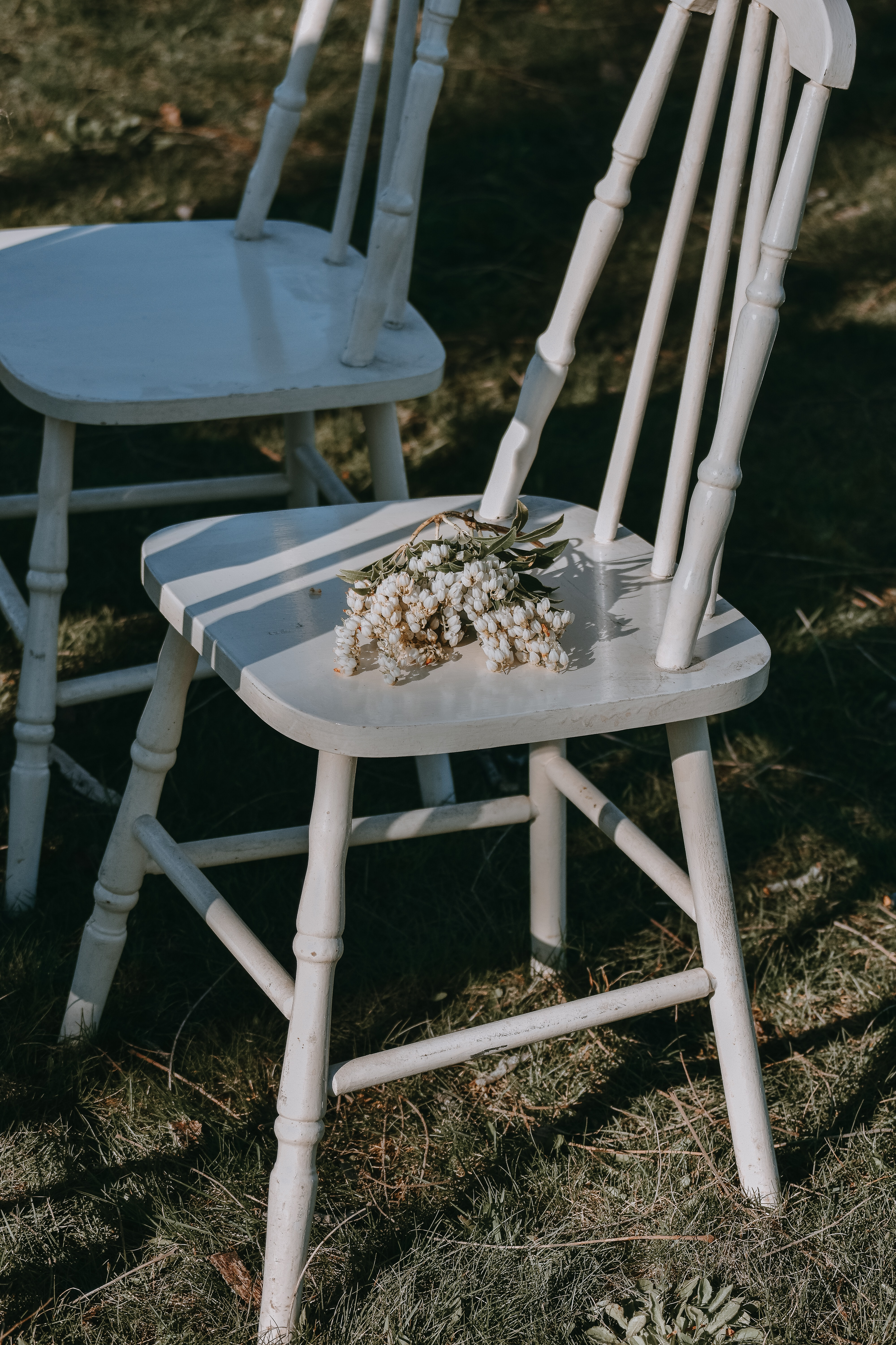 two white wooden armless chairs