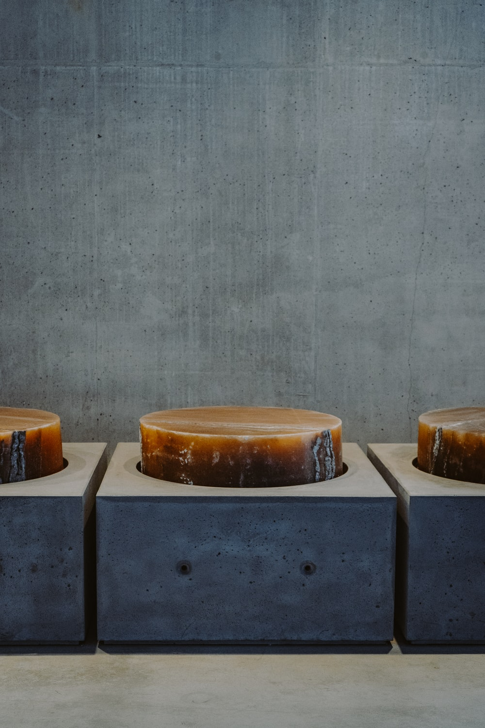 3 brown round cakes on blue table