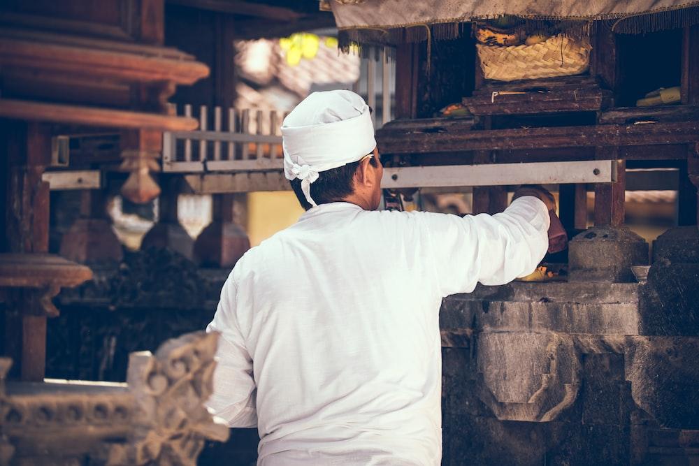 man facing rack in kitchen