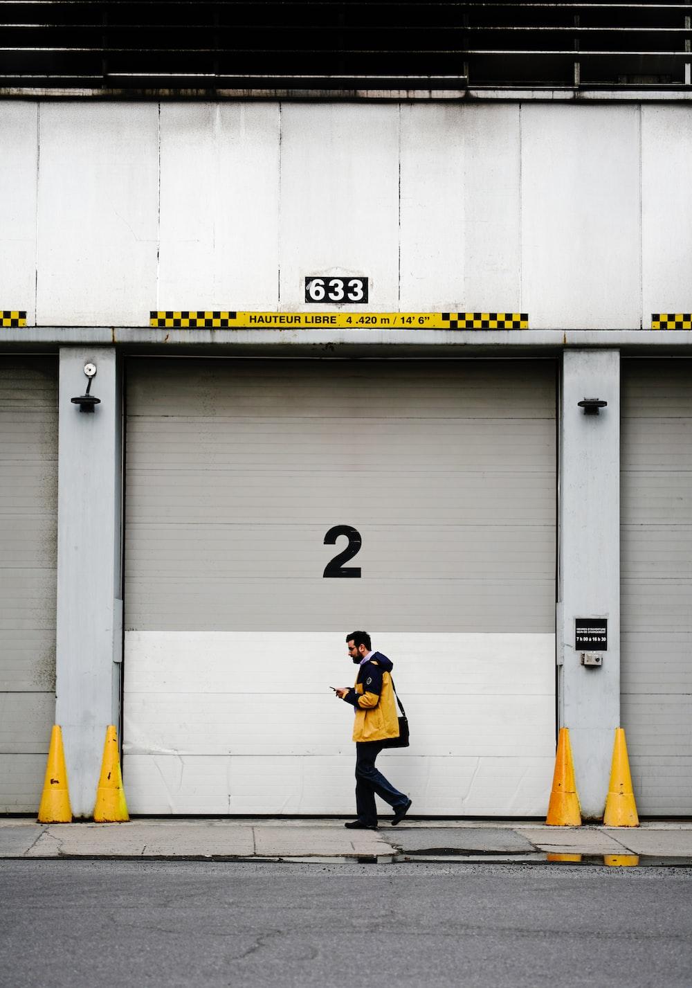 person walking past roll-up door