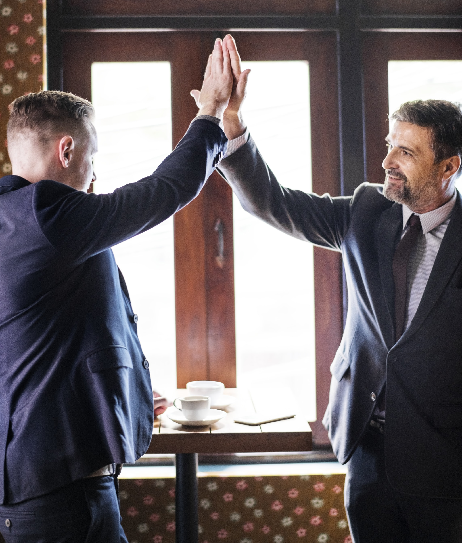 two men doing high five