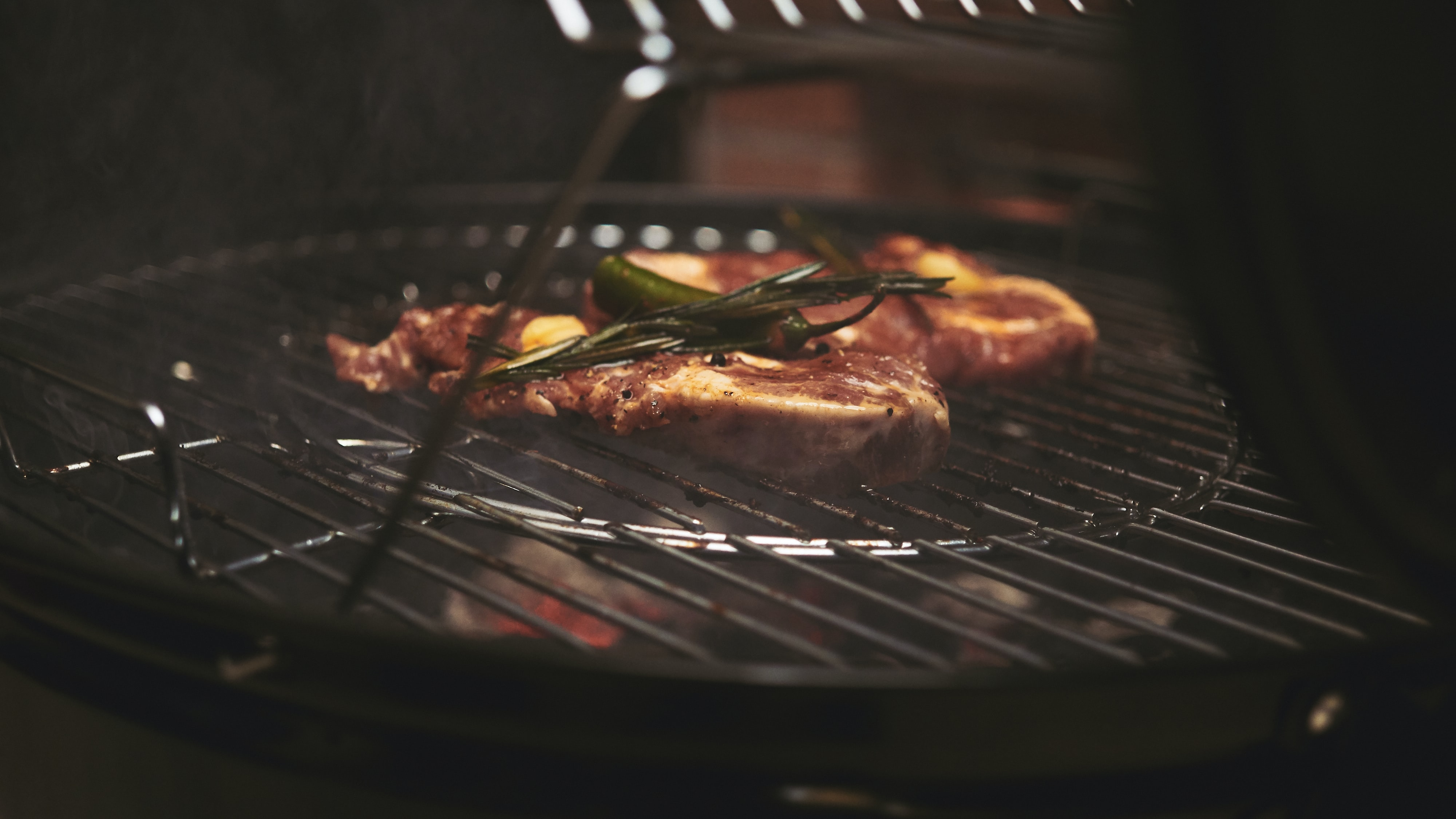 selective focus photography of grilled meat on charcoal grill