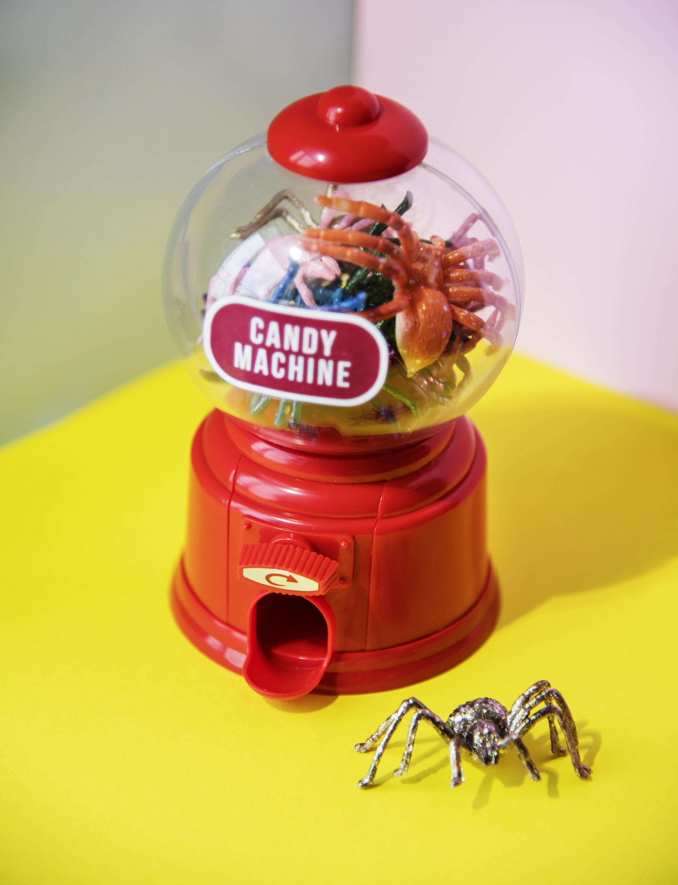 red candy machine on yellow table