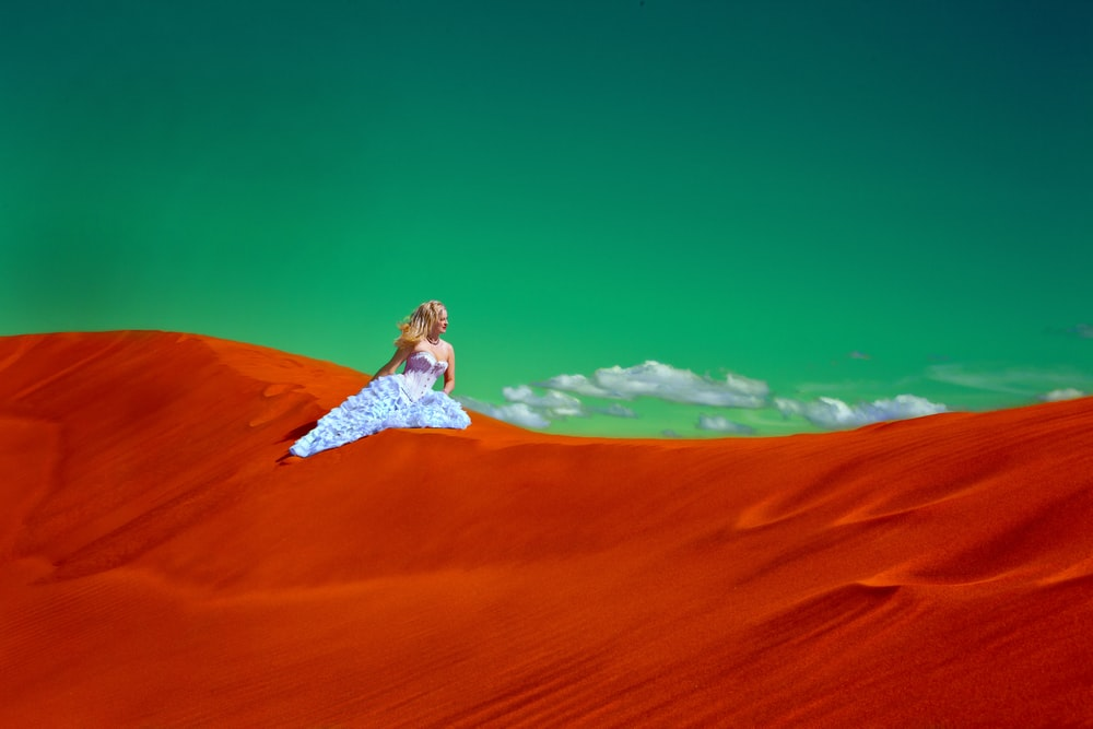 woman in white gown on desert