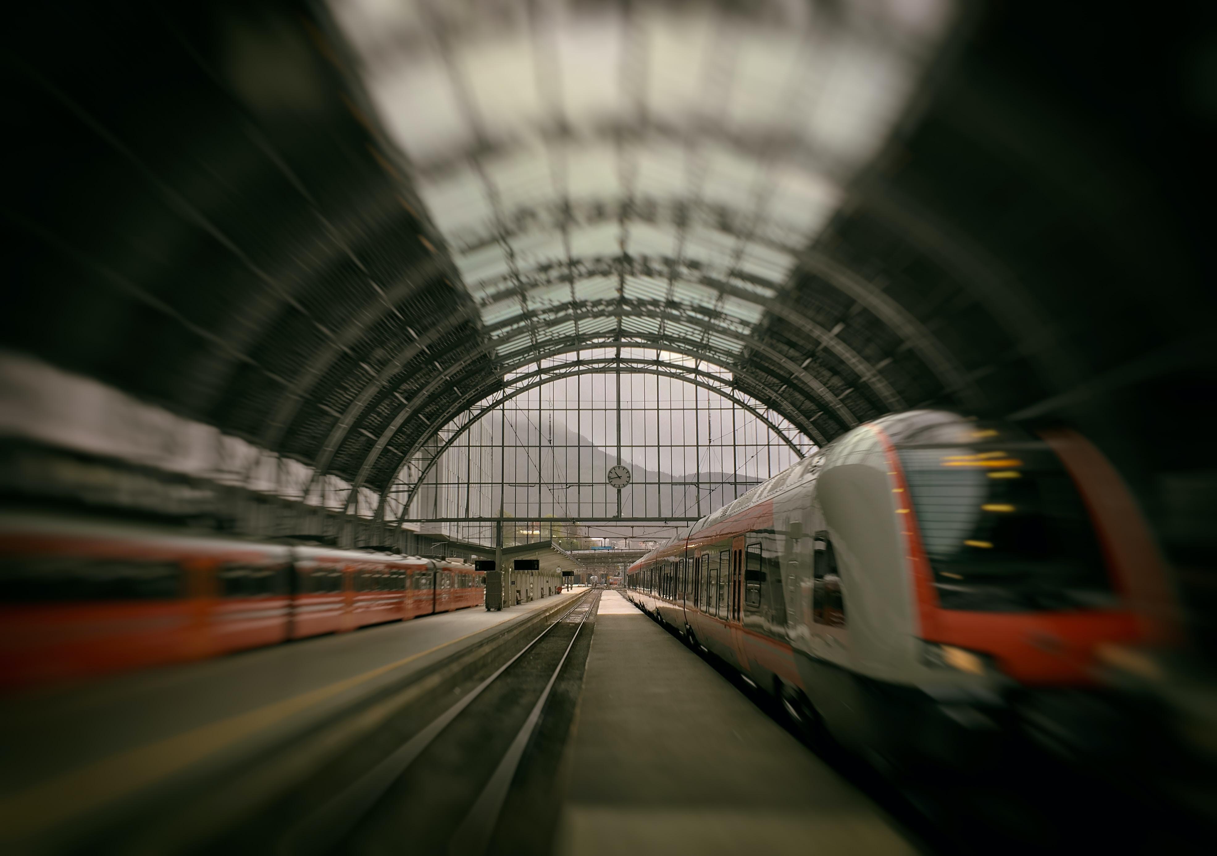 train passing on rail inside stadium