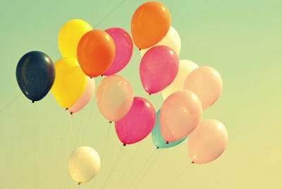 assorted-color balloons on air