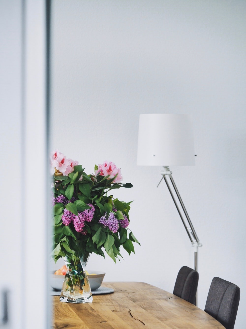 silver off-set floor lamp with white shade