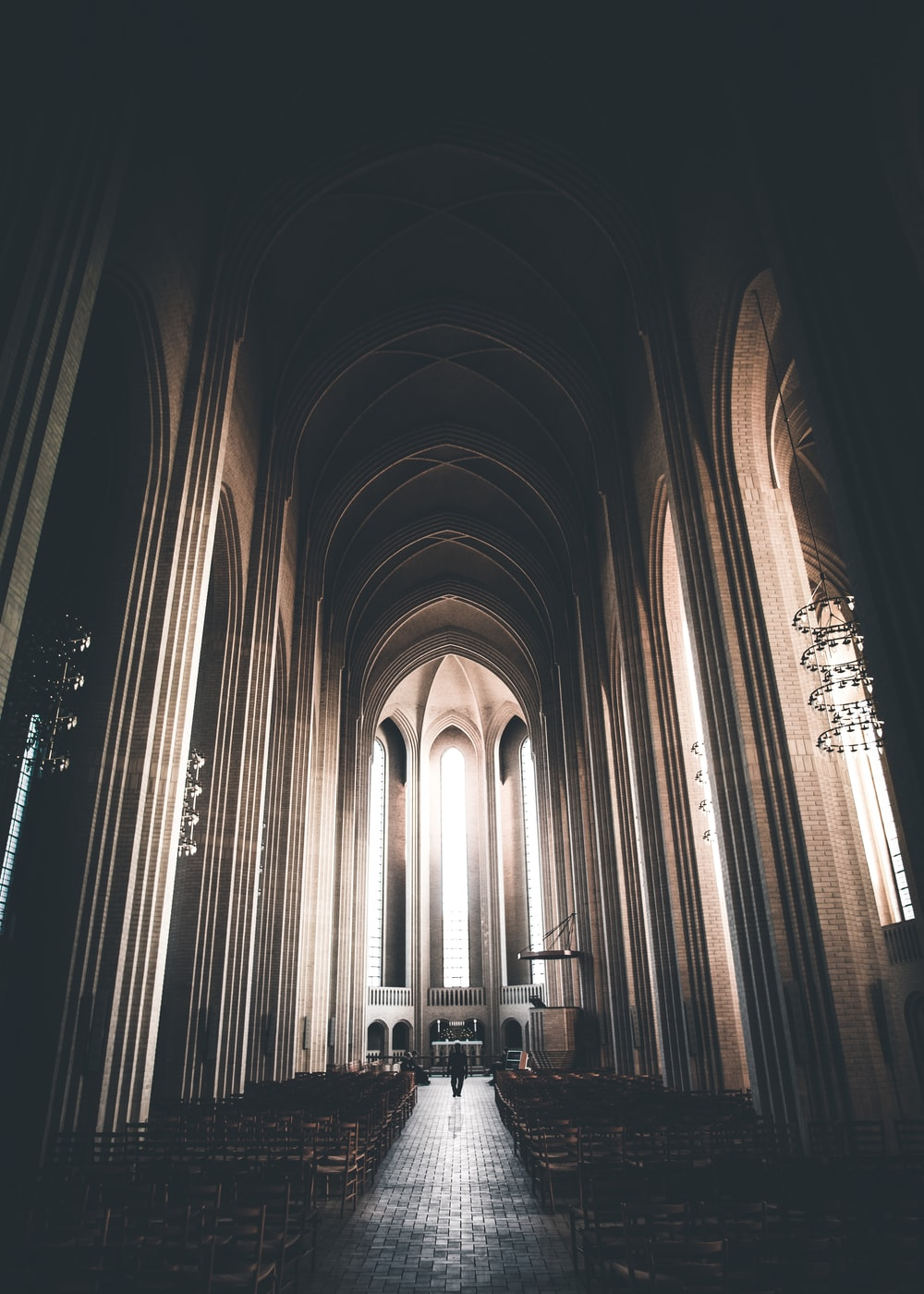 brown wooden chairs inside the cathedral