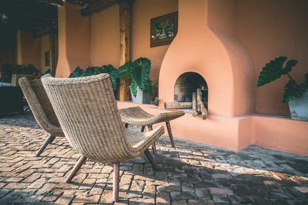 two brown wicker chairs