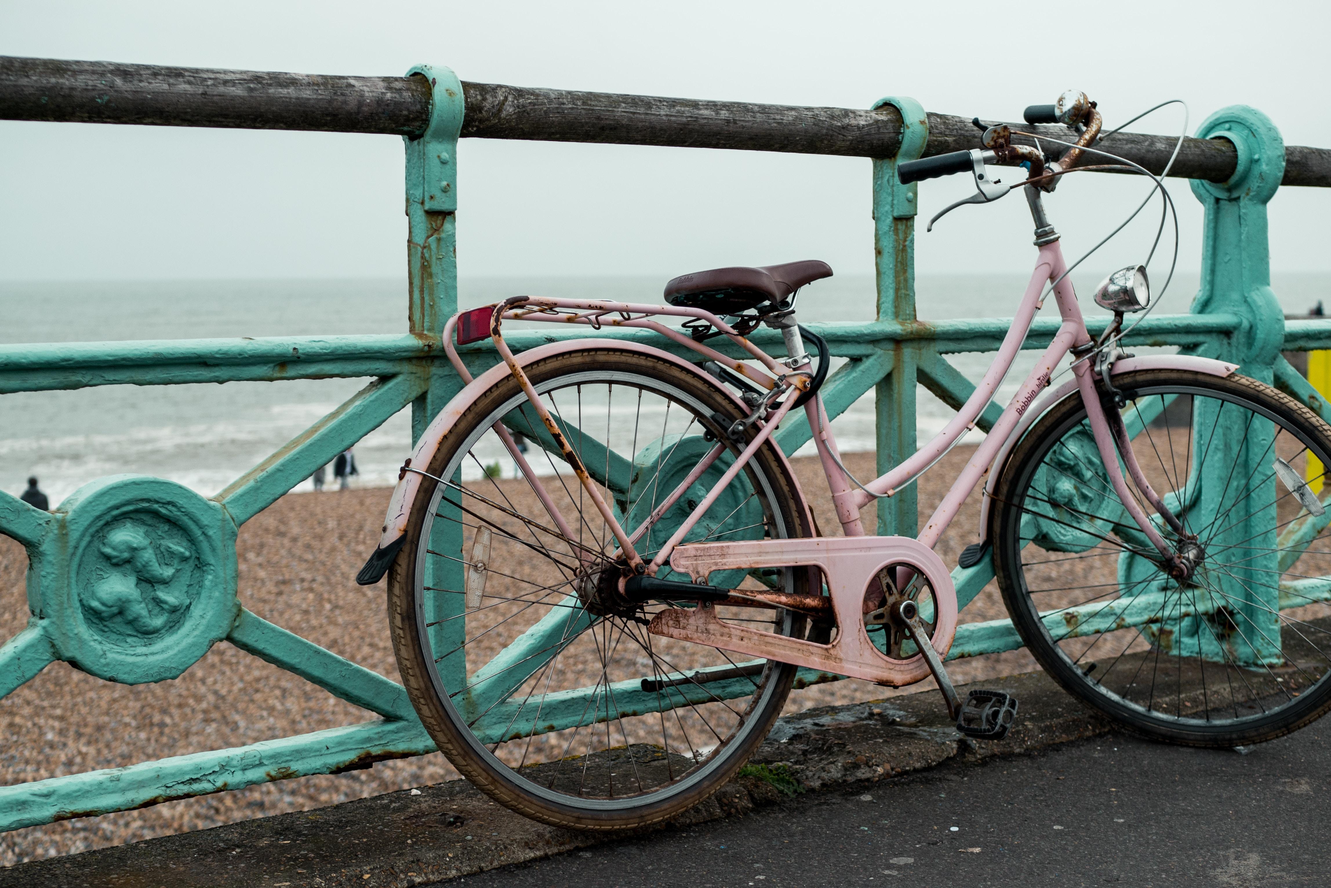 white cruiser bike near railings