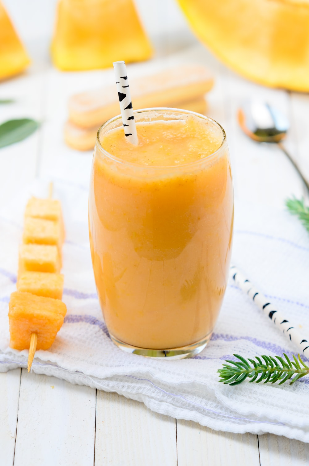 yellow fruit juice on glass cup