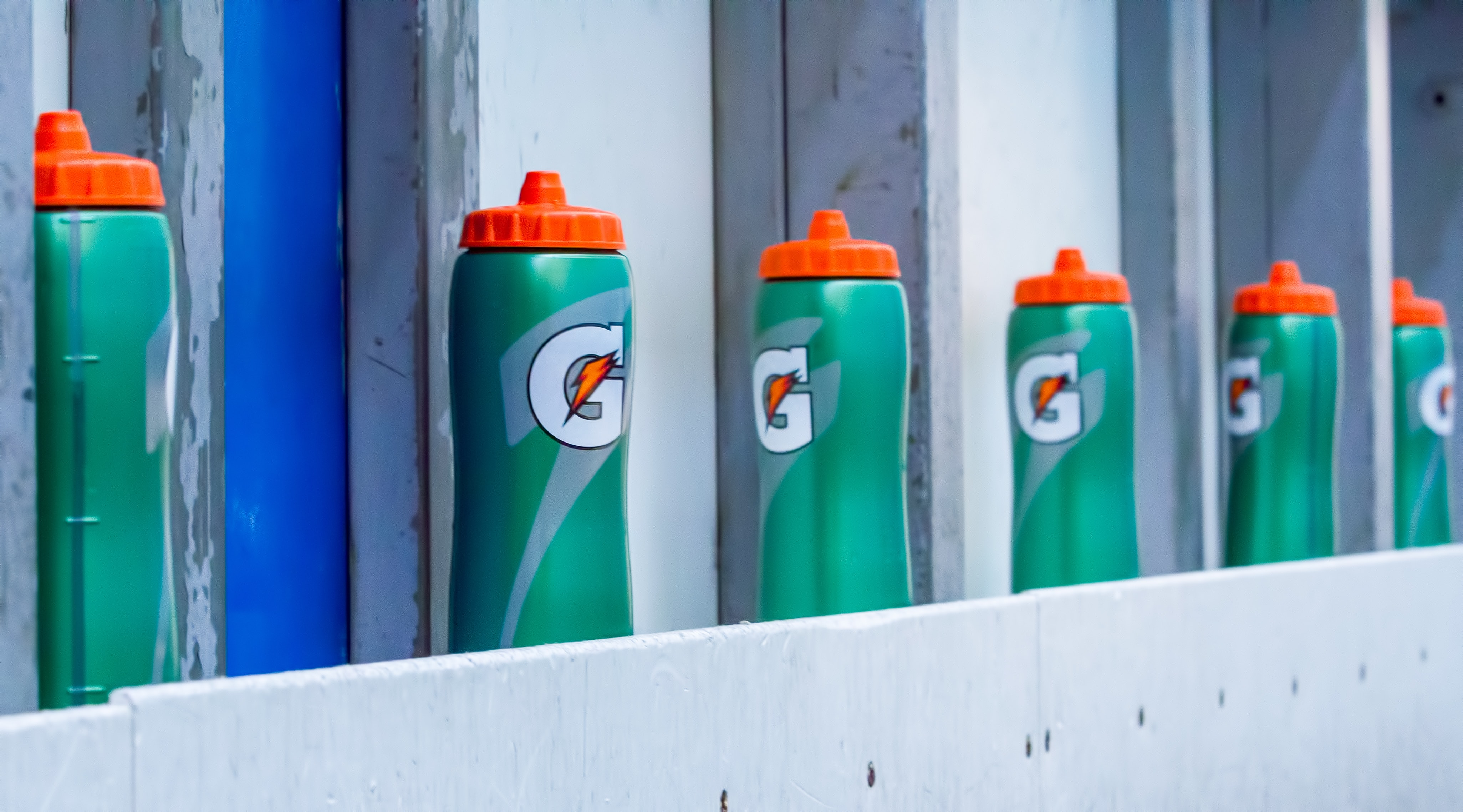 Gatorade sports bottle on top of gray surface