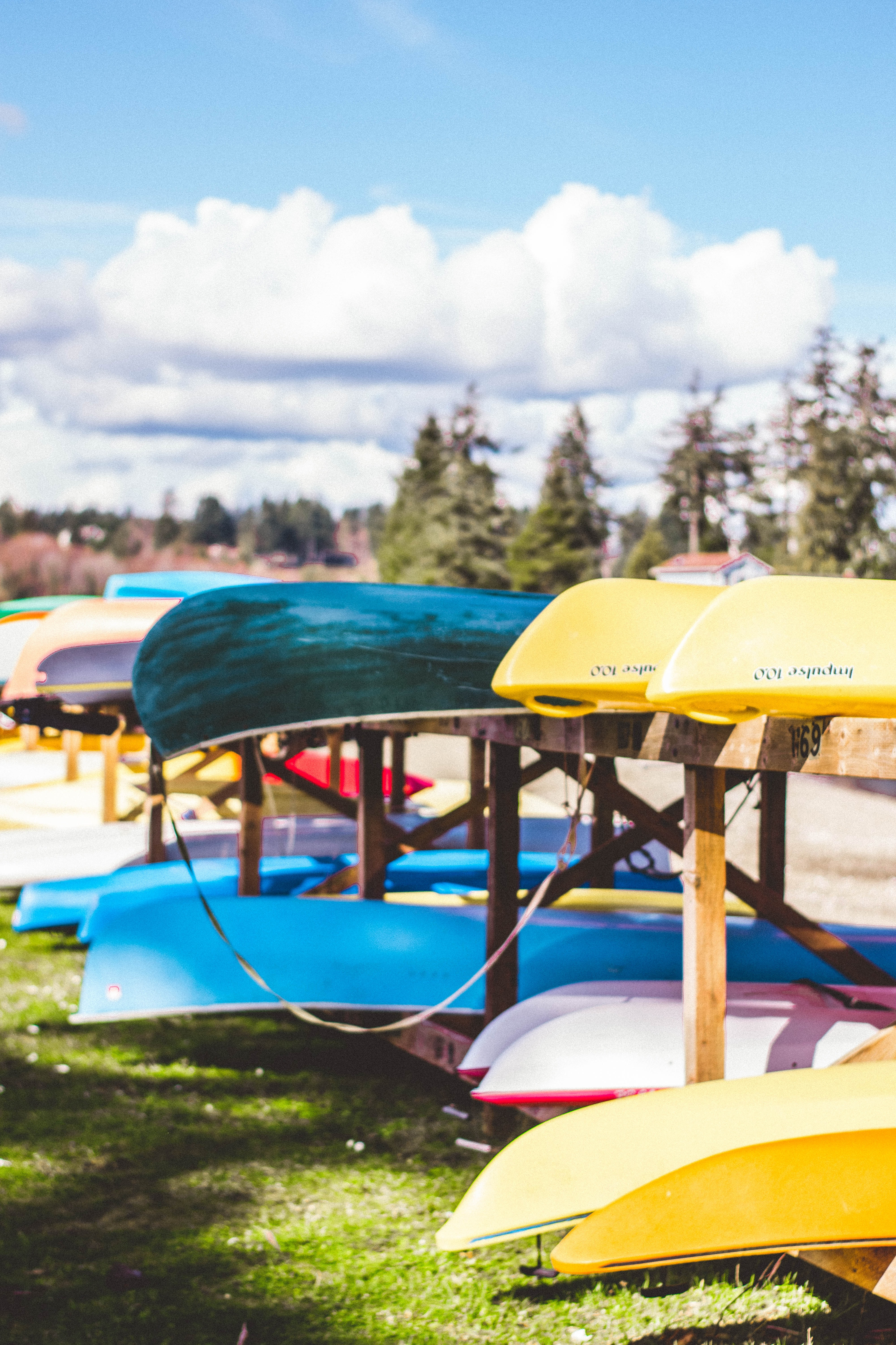 assorted-color canoe on rack