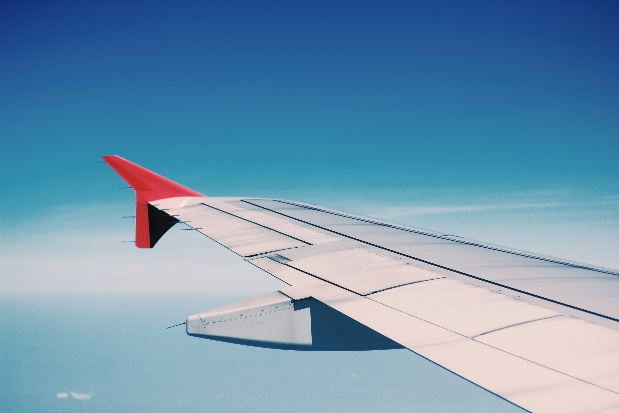 white and red airplane wing