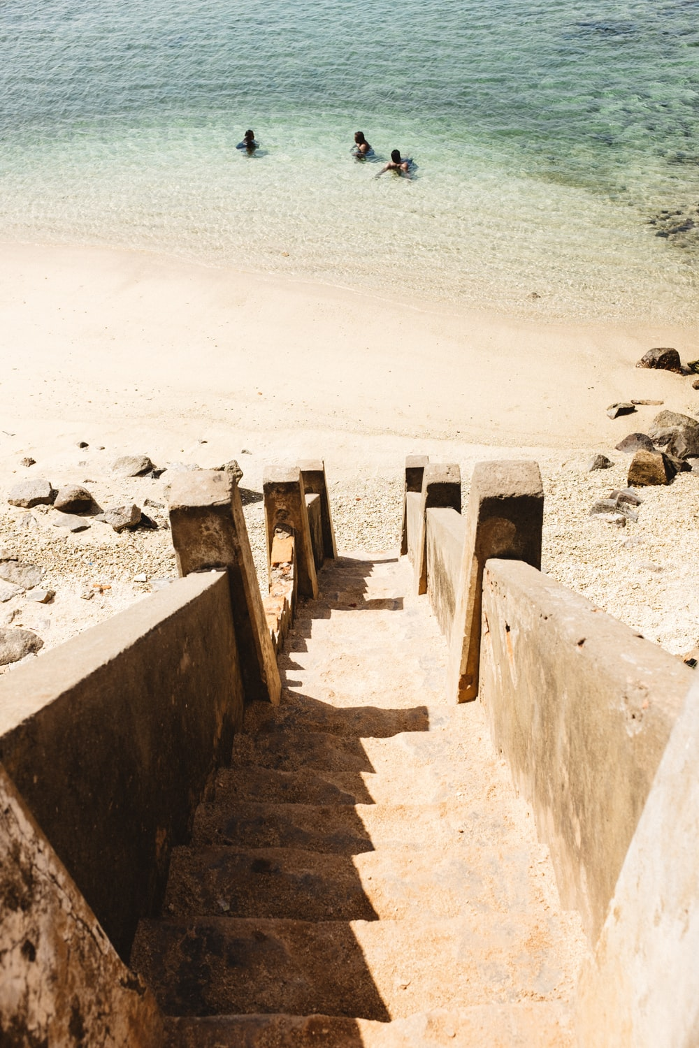 concrete stairs going to seashore