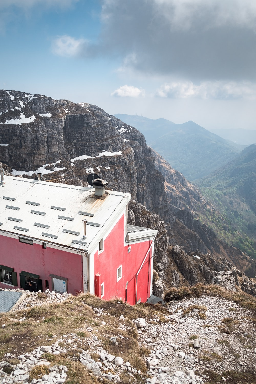 red concrete house near mountain
