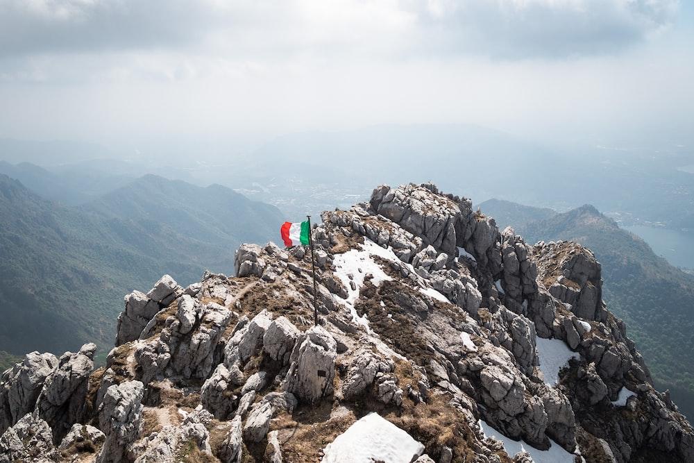flag of Italy on stone mountain