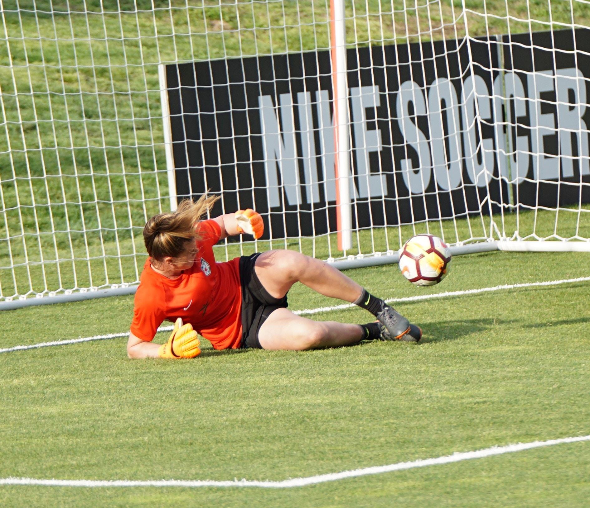 goal keeper lying on grass