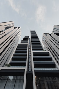 low-angle photography of black painted high-rise building