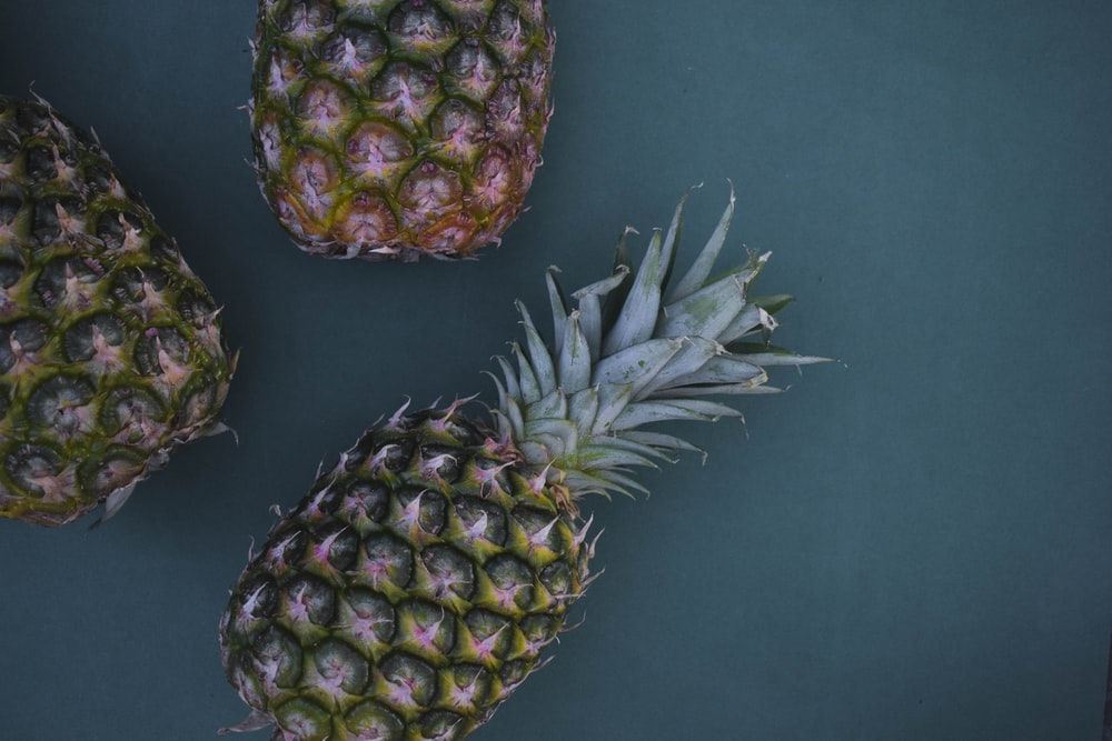 flat-lay photography of three pineapples