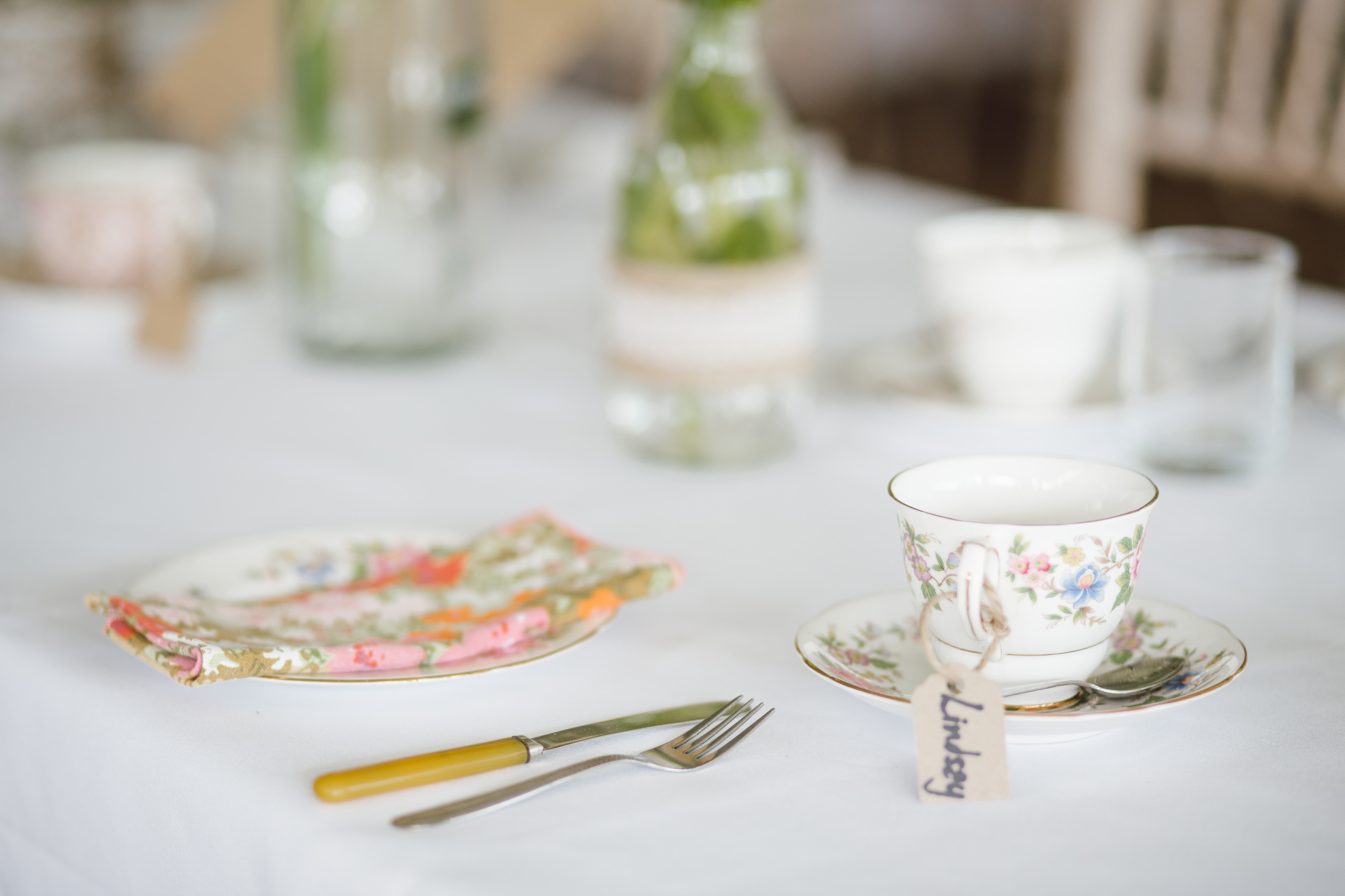 white and silver tableware on top of white wooden table