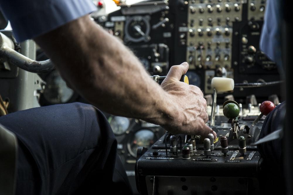 person operating black audio mixer