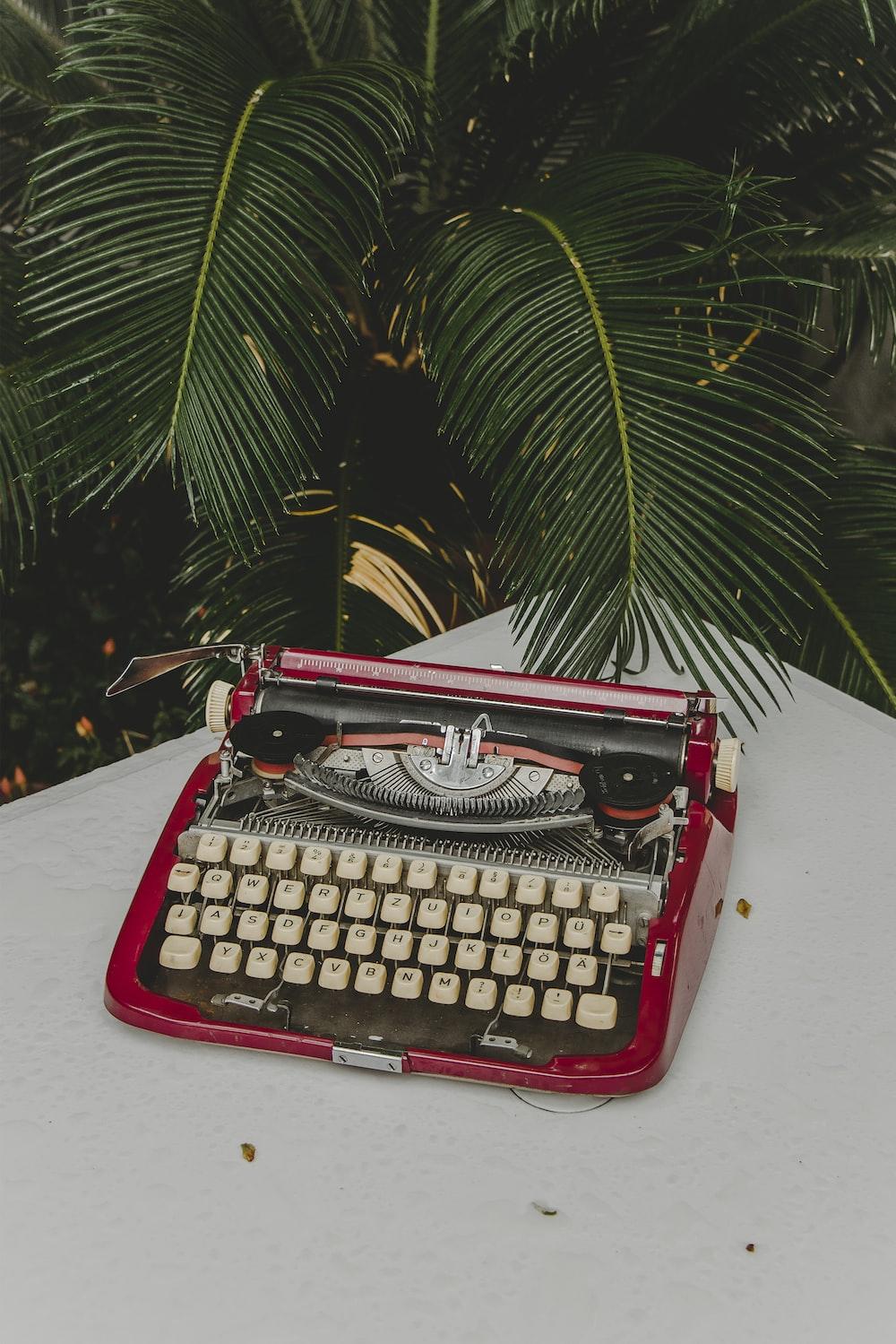 red and gray typewriter