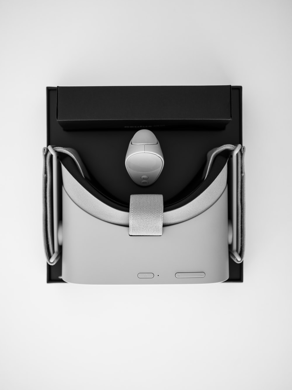 black and gray VR headset with box