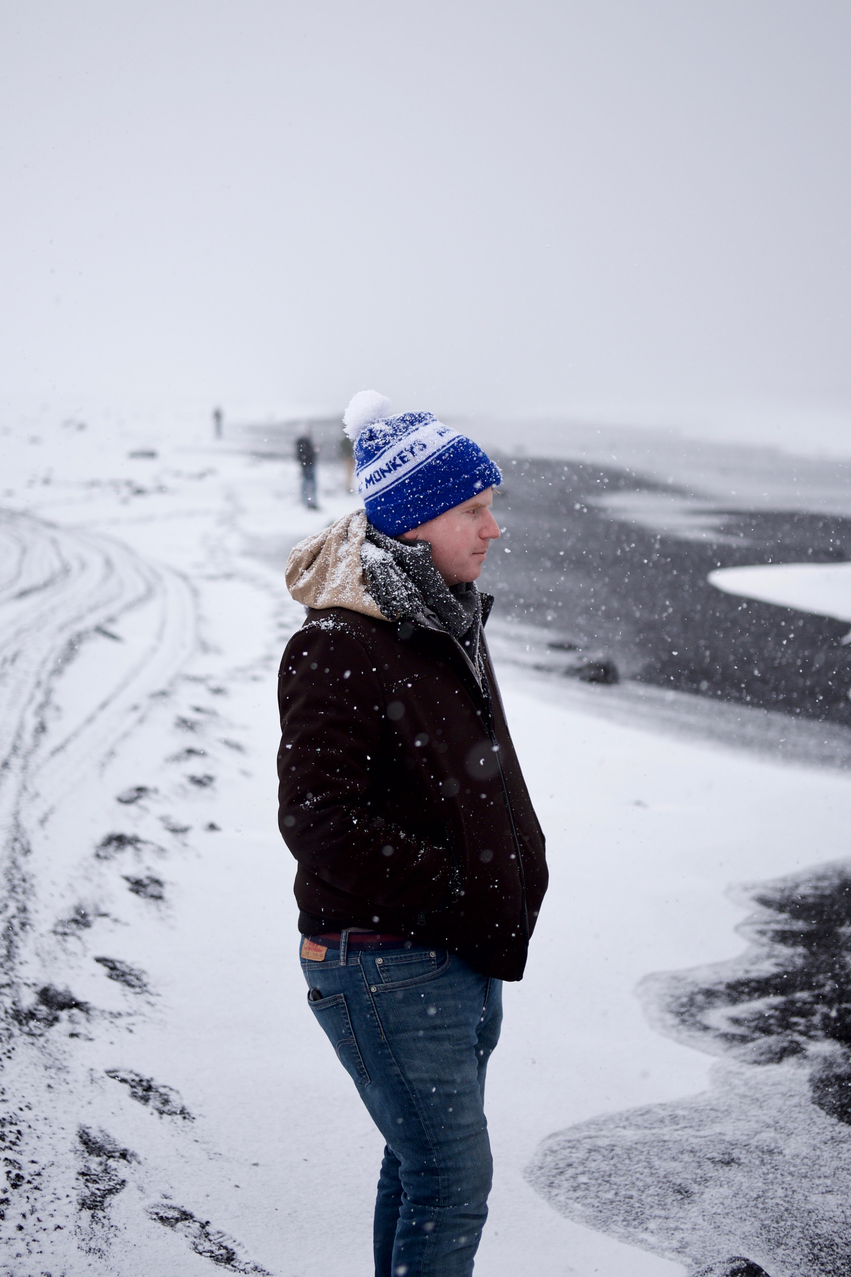 man standing on snow during winter