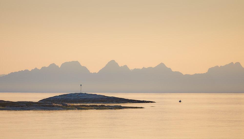 islet near mountain range