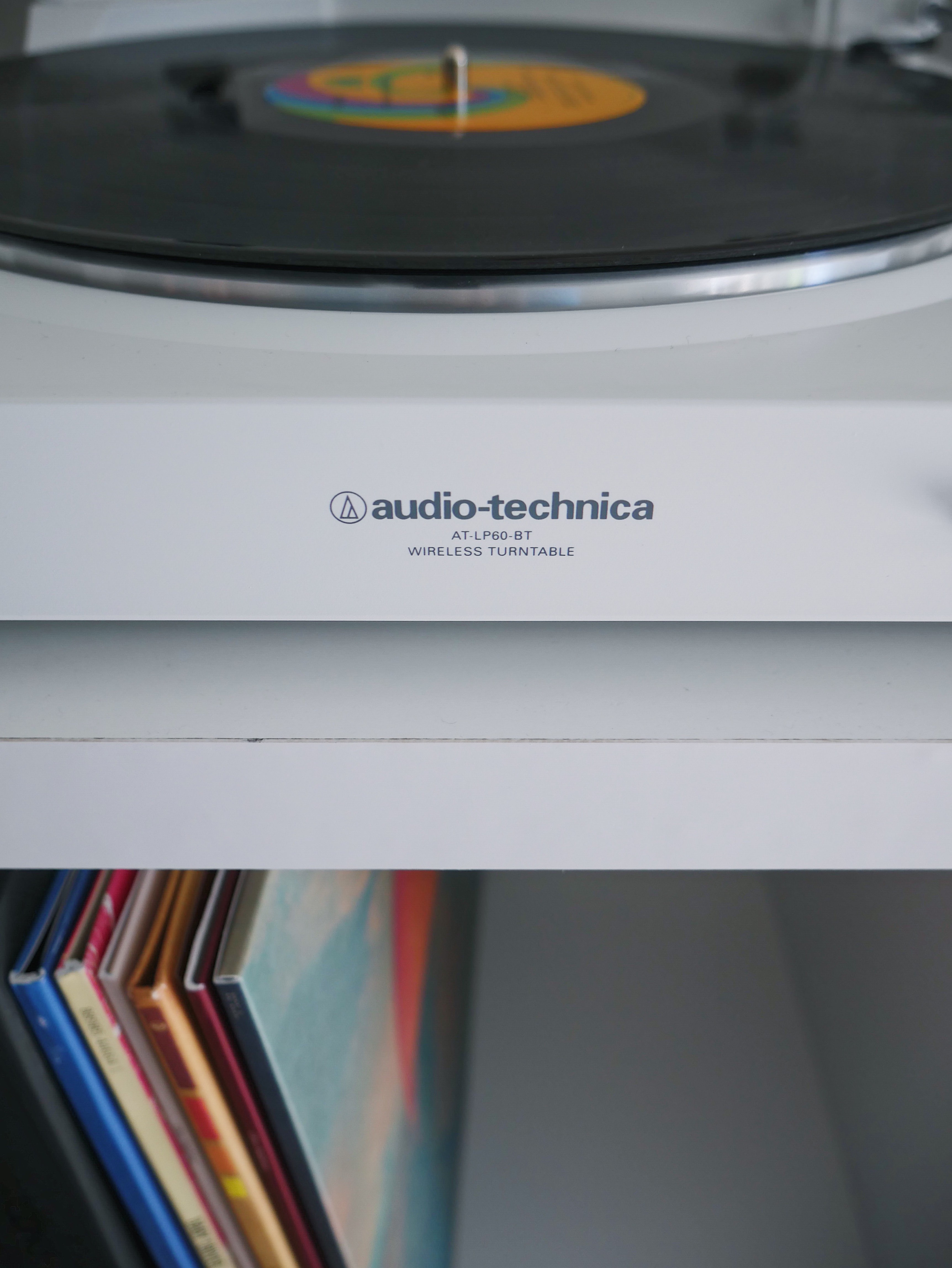 white Audio-Technica wireless turntable near vinyl record sleeve