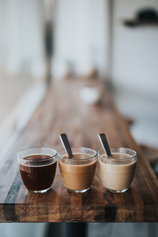 macro photography of three assorted liquids