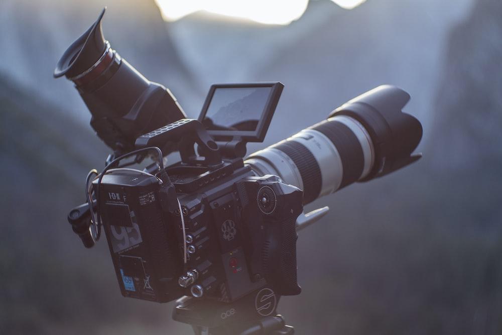 black DSLR camera taking photo of scenery