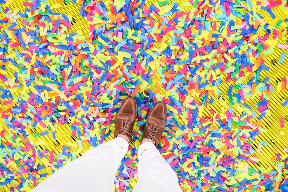person standing on confetti