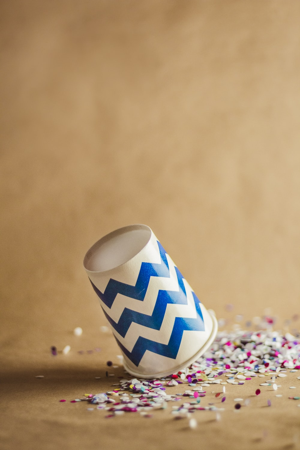 white and blue disposable cup