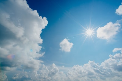 white and blue cloudy sky sun zoom background
