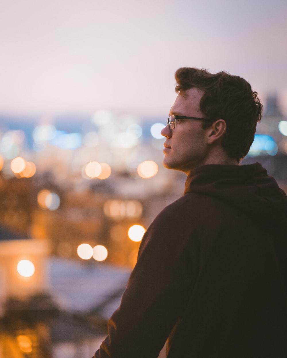 man standing wearing black hoodie