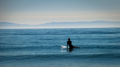 landscape photo lens of person surfing board