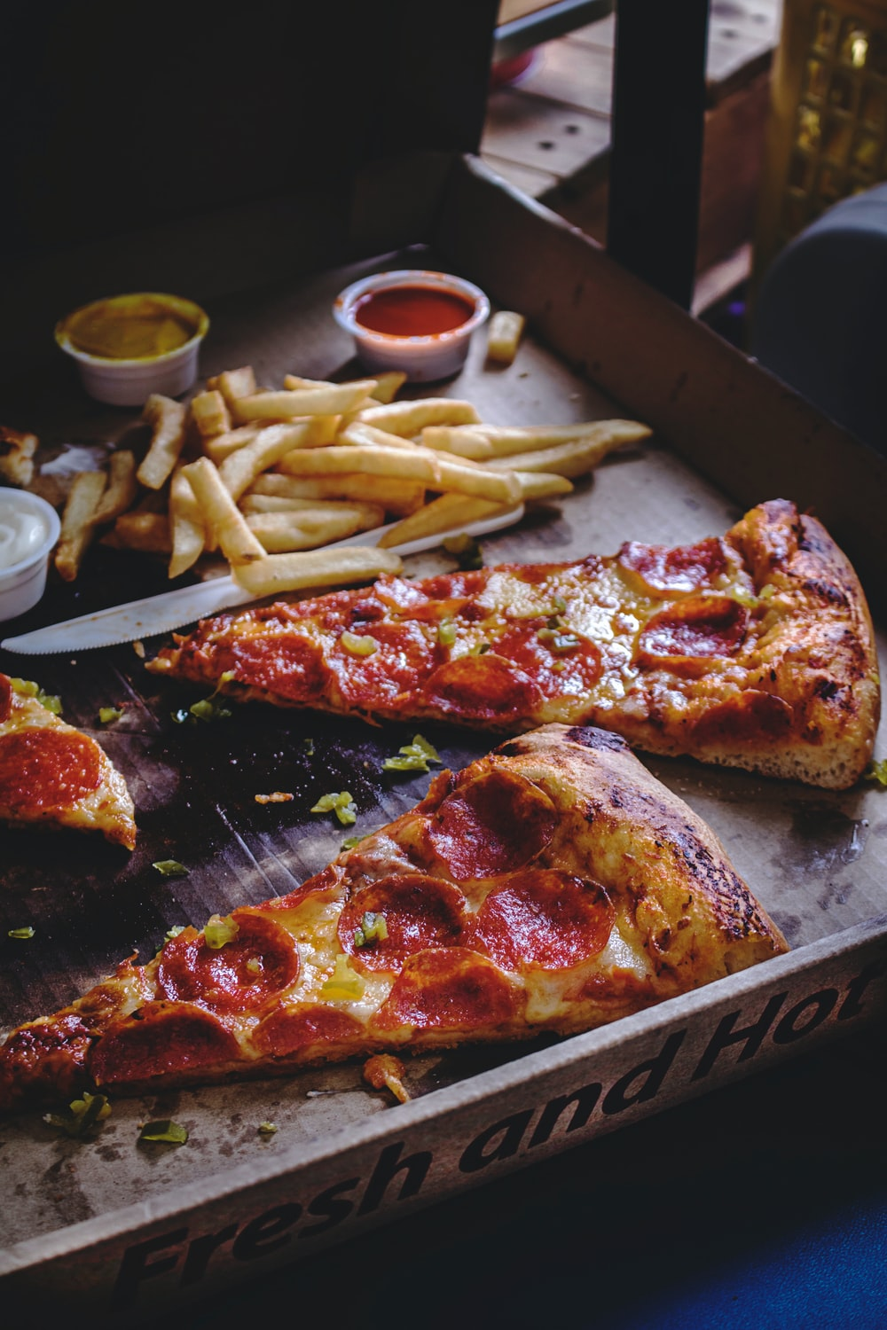baked pepperoni pizza with French fries