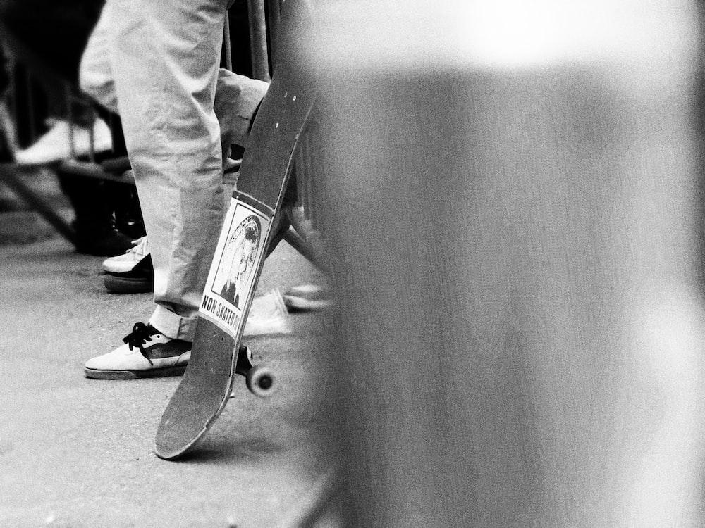 skateboard beside standing man