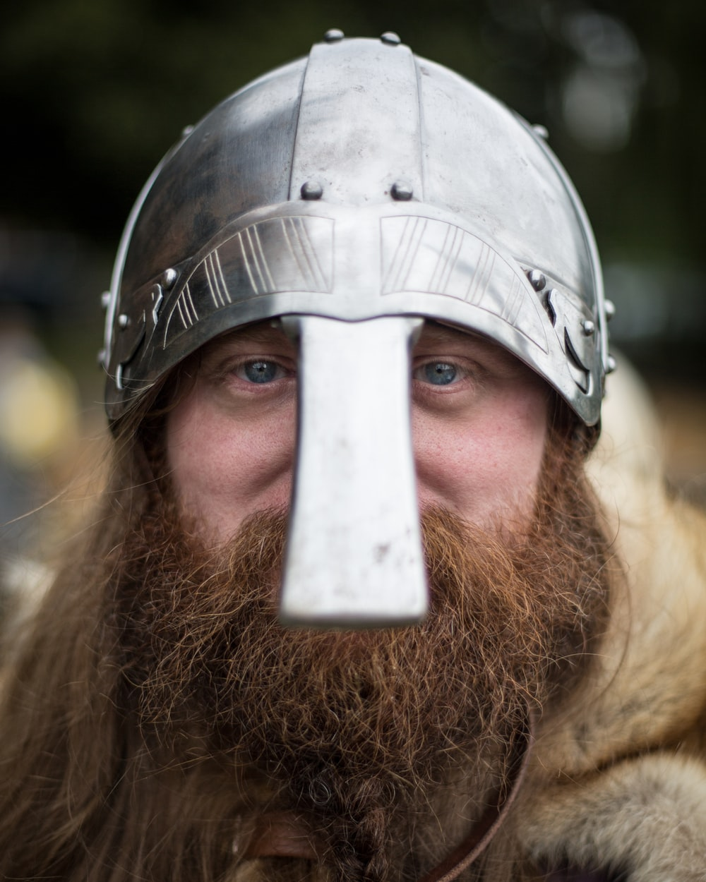 person wearing knight helmet photo