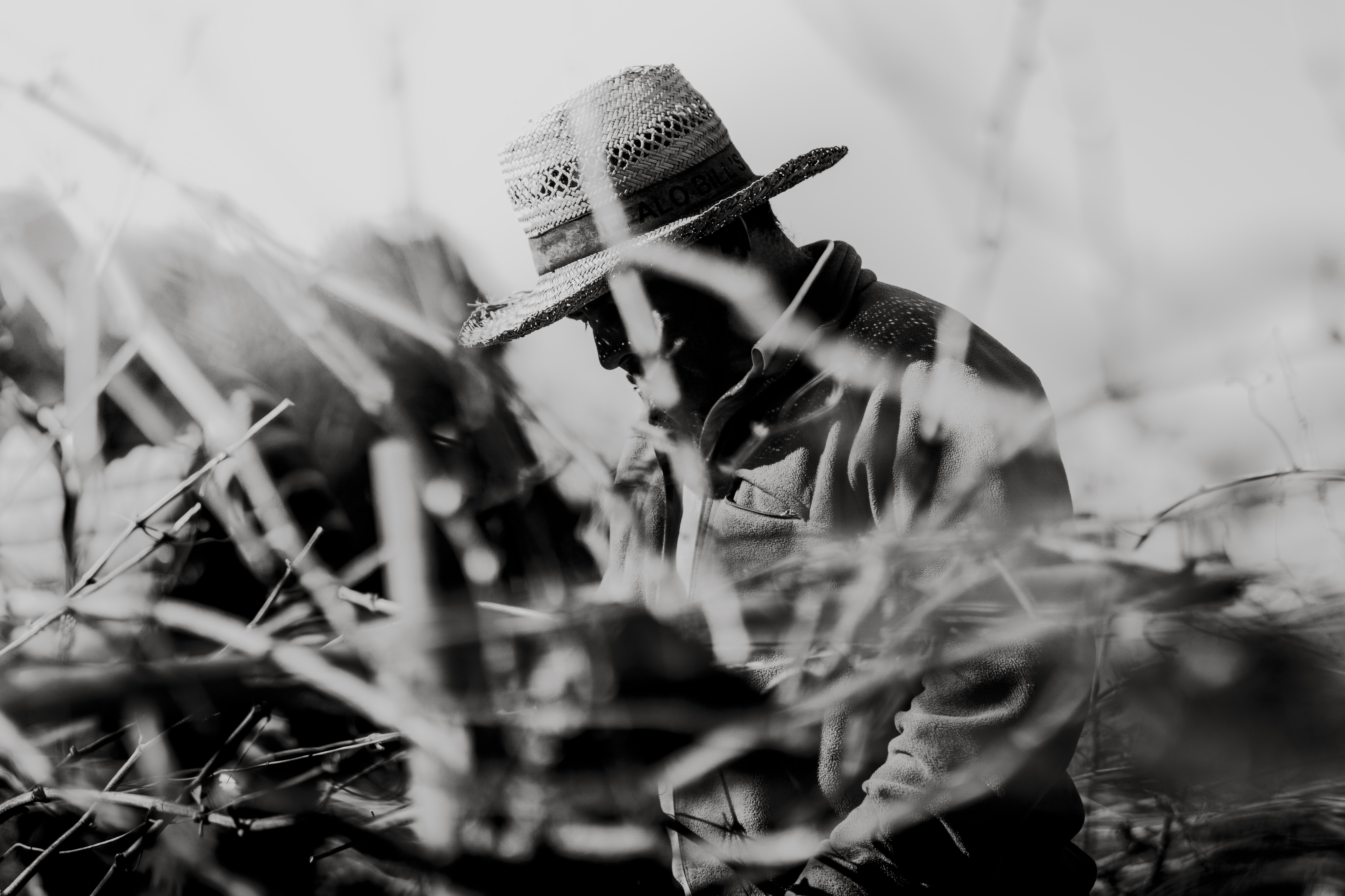 grayscale photography of man wearing hat