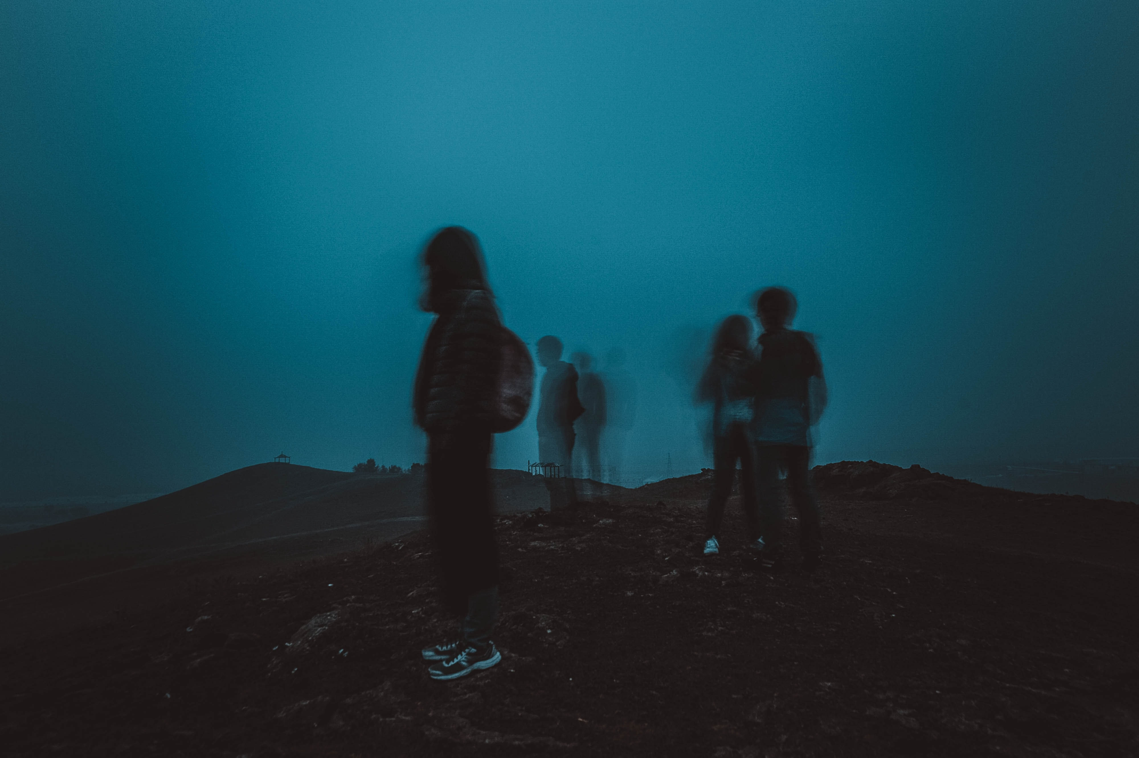 people standing on mountain