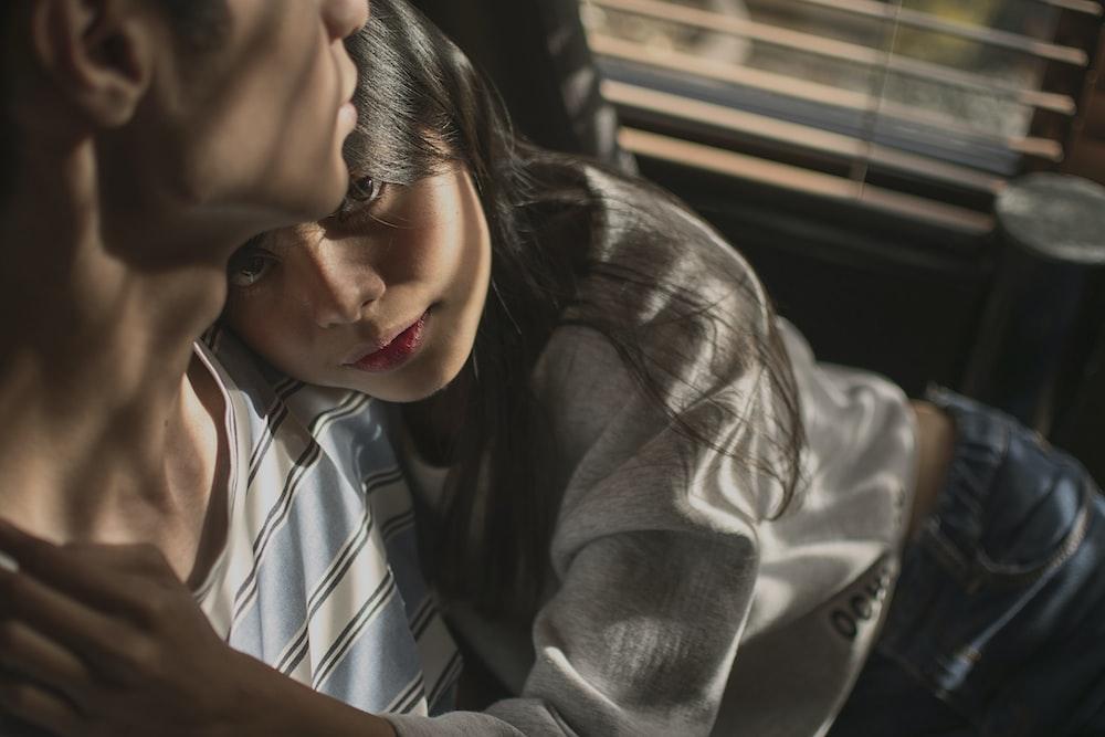 girl hugging man inside dark room